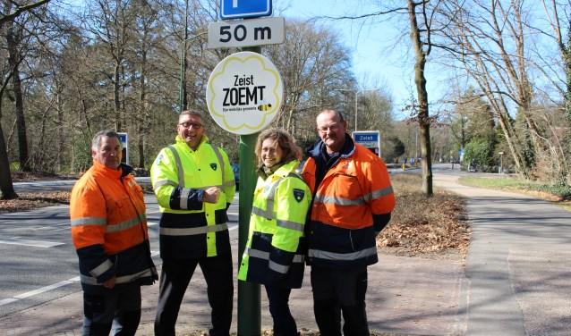 Het bord Bijvriendelijke gemeente is geplaatst aan de Driebergseweg (bij een kombord) nabij de Molenweg.