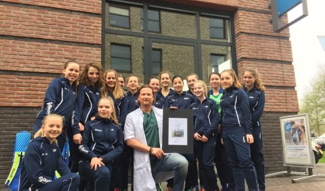 Hockeyteam MC1 met dierenarts Mark Huis in 't Veld