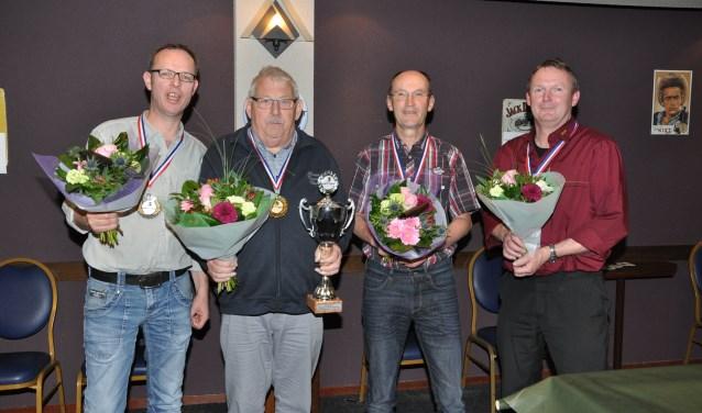 Op de foto van links naar rechts. Bart Aben, kampioen Jan van Tilborg, Thieu Janssen, Peter Toonen.