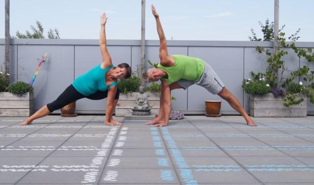 Tijdens de Yogadag op donderdag 21 juni worden er lessen gegeven op het dakterras.