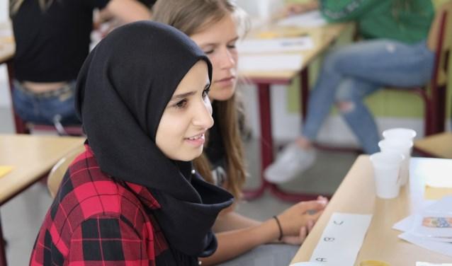 De leerlingen op het Stanislascollege kregen voorlichting over geld en het voorkomen van schulden.