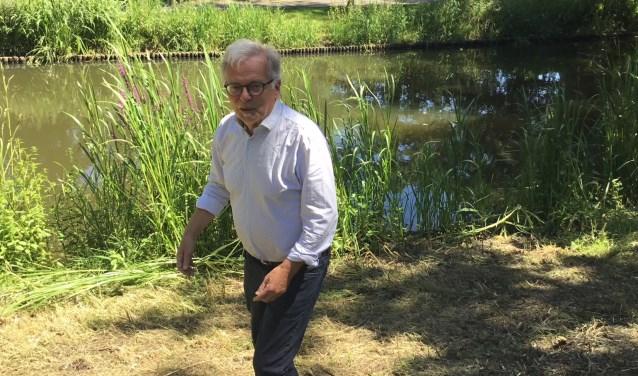 Piet van den Boom bij de Eindhovense Dommel. (foto DFP)