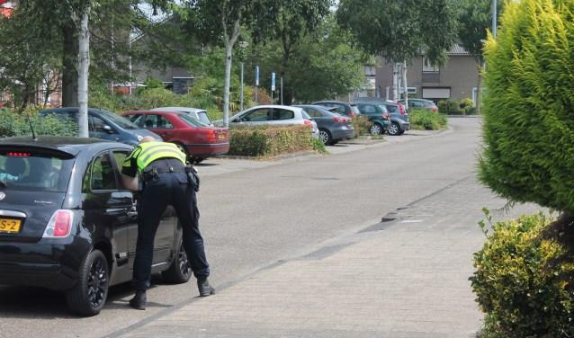 De politie hield gistermiddag een buurtonderzoek. Foto: GinoPress BV