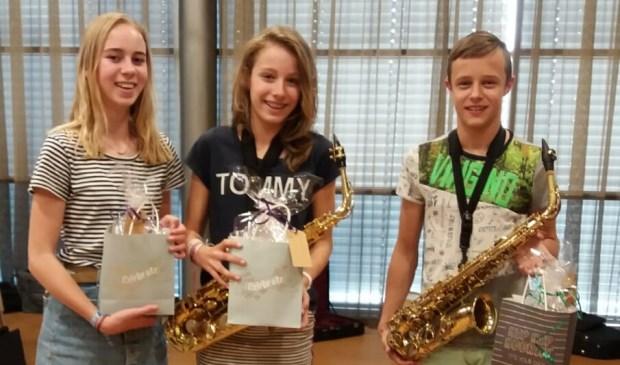Drie trotse KNA-leerlingen. Eigen foto