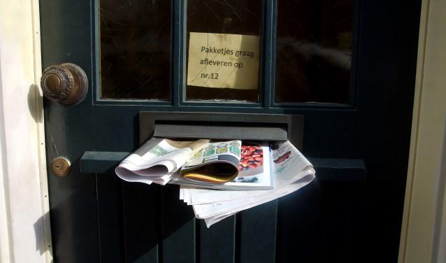 Het is duidelijk: de bewoners van dit huis zijn niet thuis. Handig voor inbrekers om te weten.....