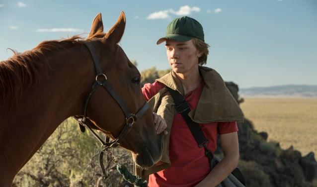De vijftienjarige Charley Thompson sluit vriendschap met een oud renpaard. (foto: Scott Patrick Green)