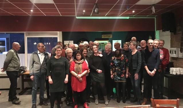 Alle vrijwilligers met vooraan links Mireille Mieremet van Sportcafé Duyf.
