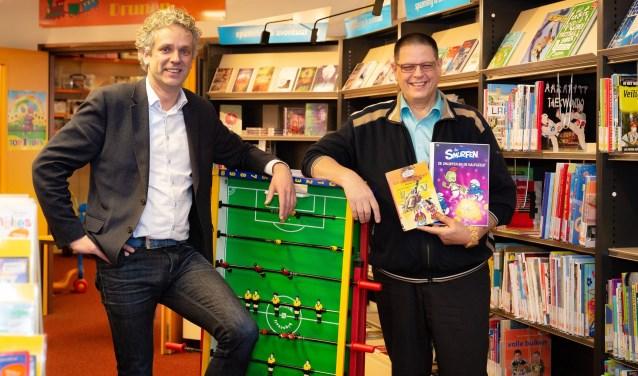 Sergei Versteeg en Ron Prins beschouwen de krachtenbundeling van bibliotheek en speel-o-theek als een win-winsituatie voor beide partijen. Foto: Yuri Floris Fotografie