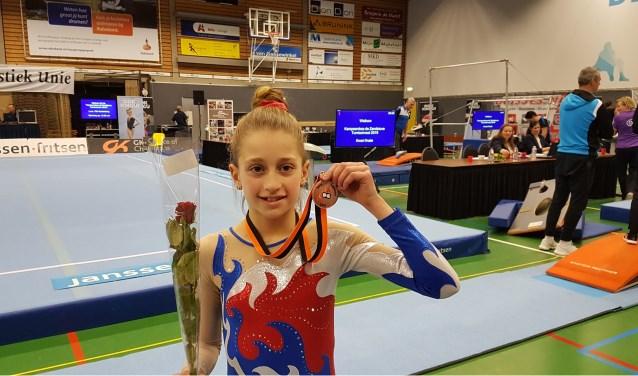 Maura troonr trots haar bronzen medaille