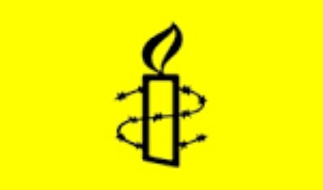 Amnestygroep Veldhoven voert actie op Internationale Vrouwendag.