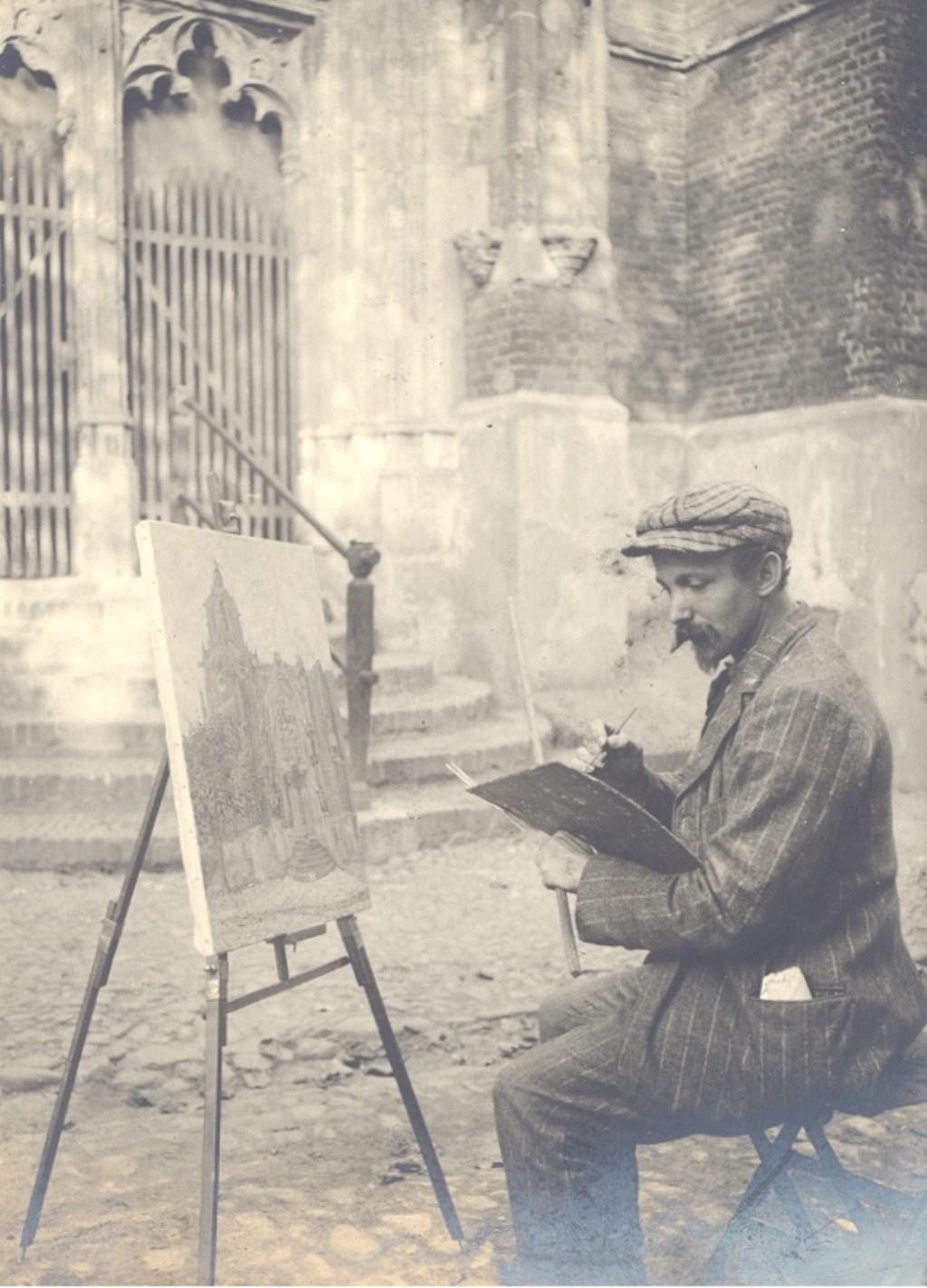 Schilder Dirk Jansen in 1908/1909 aan het werk. (Foto: dr. W. Waller, Rhenen)  © Persgroep