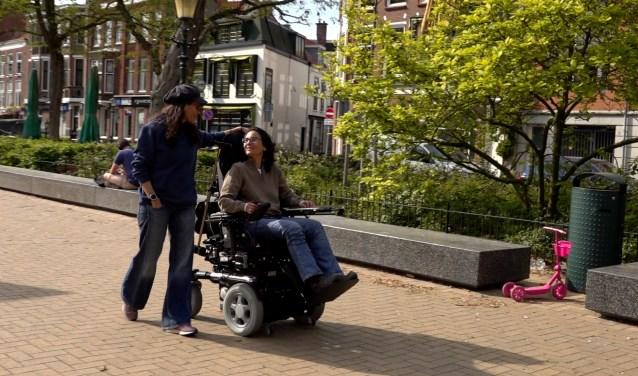 Marianne (in rolstoel) en Bo