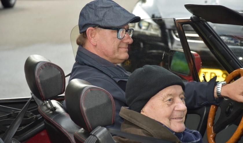 Een stralend gezicht tijdens het ritje in de Cabrio.