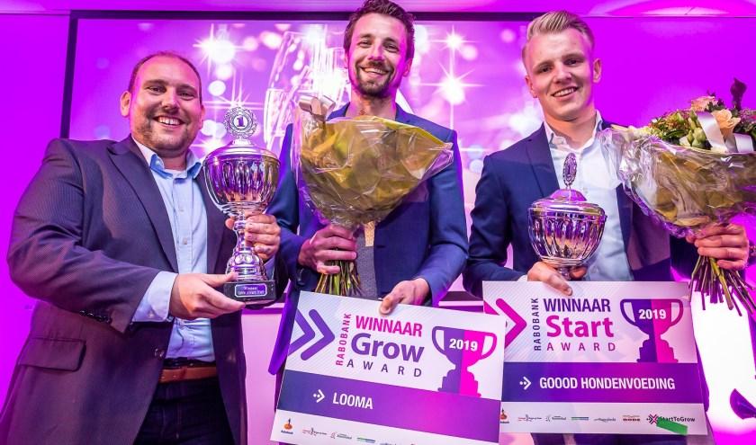 Winnaars v.l.n.r: Robert Breedveld en Pieter Dekker (Looma B.V.), Twan Tak (Goood hondenvoeding)