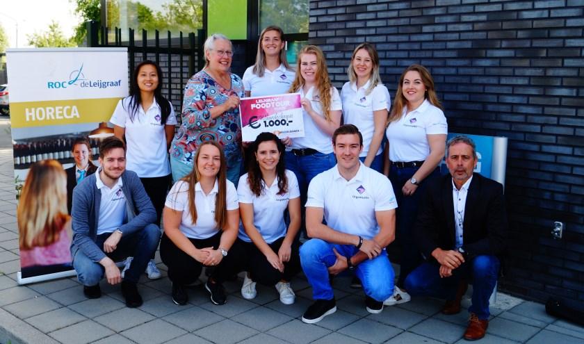 Leijgraaf FoodTour Cuijk doneerde 1000 euro aan Voedselbank Land van Cuijk. (eigen foto)