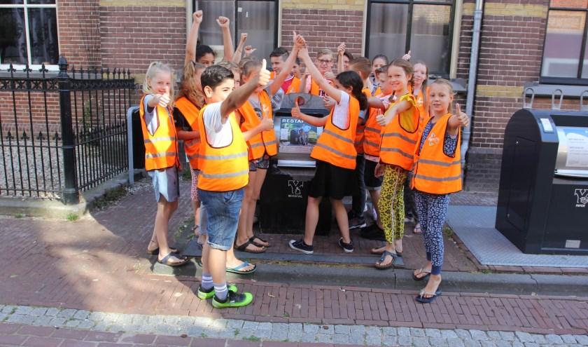 Kinderen van de Koningin Beatrixschool in Culemborg deden met Wethouder Joost Reus de Ren je Rol-afvalestafette.