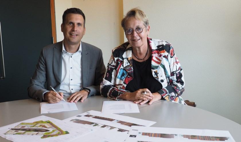 Roel Wijlens van Koopmans Bouwgroep en Marian Teer, van Woonstede. (Foto: Karin Gijssen)