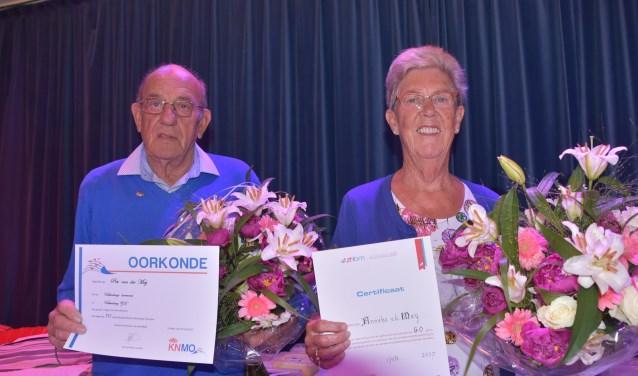 Piet en Anneke van der Meij 70 en 60 jaar lid van Valkenburgse Harmonie. | Foto: Piet van Kampen.
