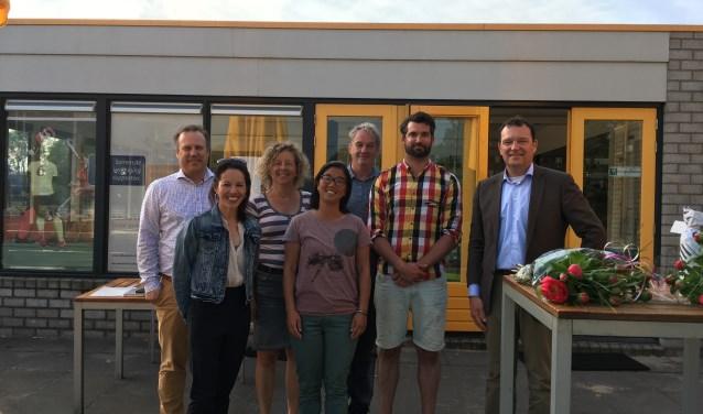 Het bestuur van Alecto met Tembi Schneider (voorste rij, tweede van links) en Stefan Duyf  (tweede van rechts).