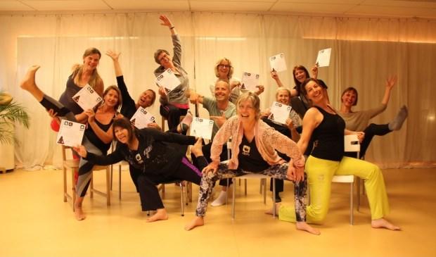 Dina Leergaard (linksachter) geeft Do-In Yoga bij sportschool Kaizen. | Foto: pr.