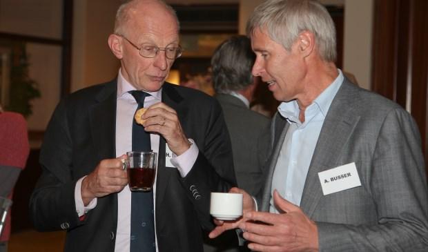 Busser (rechts) tijdens een bijeenkomst in 2014.