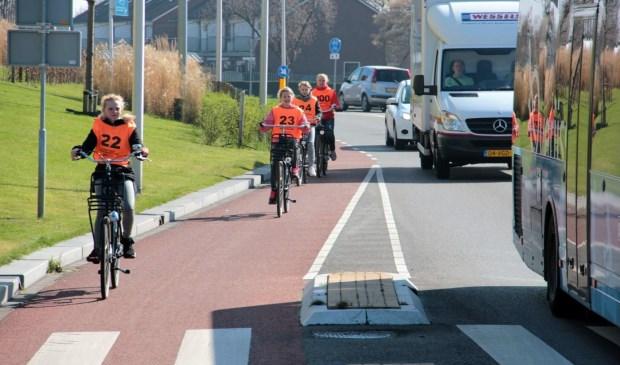 Het verkeersexamen is het enige moment dat je wel weet wat een fietser gaat doen.