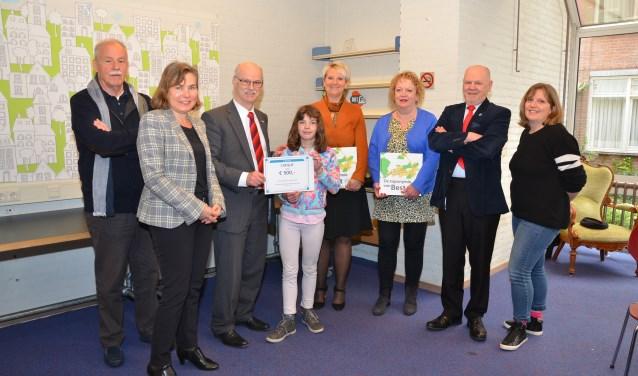 Van links naar rechts: Paul Maas, Valerie Vermeer, Paul Gondrie, Vera Last, Katinka van Boxtel, Ingrid van Beek, Jur Wijchers en Mirjam Verbist.