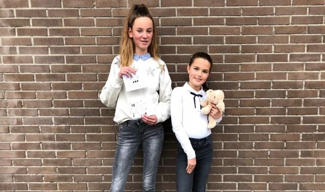 Maike Clement (12) en Indy Dautzenberg (11) nodigen iedereen uit om zaterdag 8 december met hen hun creativiteit in te zetten voor het goede doel