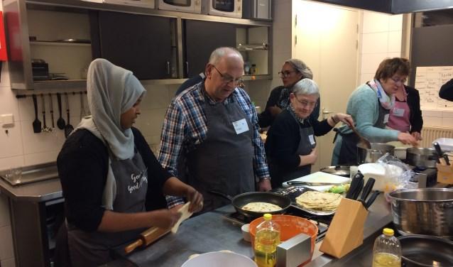 Samen genieten van lekker eten afkomstig uit alle windstreken van de wereld tijdens de Smaak van Balkum