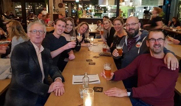 Medewerkers van De Slock en de 12 Balcken gezamenlijk aan tafel in Hilversum.
