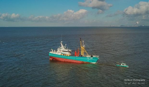 De vastzittende TX 38 voor de kust van Stellendam.