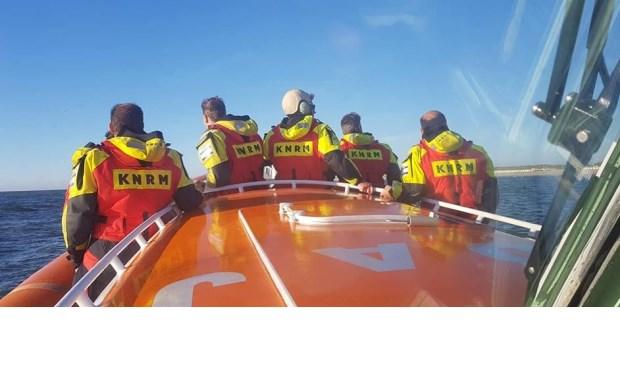 De bemanning van de Beursplein op uitkijk bij paal 21.