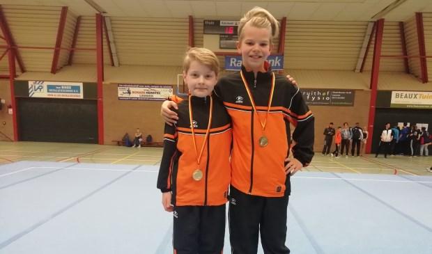 Patrick Hanenburg en Boas Westerdijk (de kampioenen).