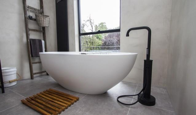 Badkamer Met Gietvloer : De spaan showroom uw showroom voor badkamers stukadoorswerk en